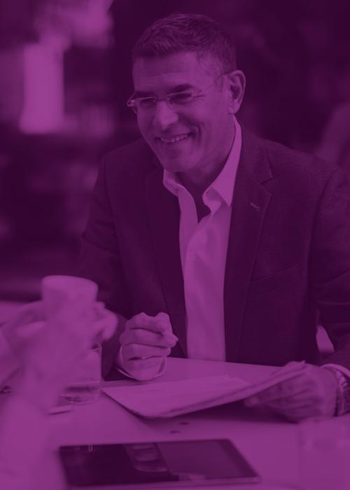 man in purple shirt laughing