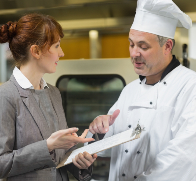 chef and manager talking in kitchen