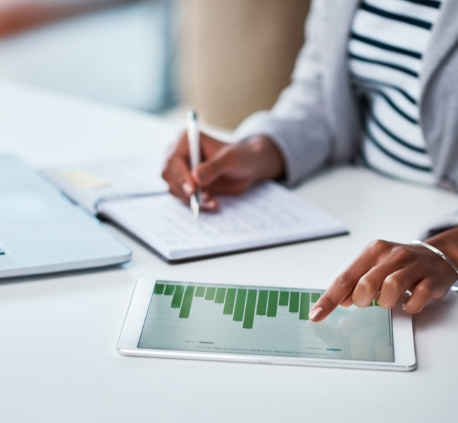 woman using tablet to look at data chart